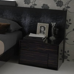 Nightfly Right Nightstand - Ebony - Get that ultra-modern bedroom look all straightened out with the Nightfly Right Nightstand - Ebony. After all this ebony-finished wood nightstand has a super-straight wood grain that creates a stylish but subtle stripe effect and it shines brightly thanks to the heavy lacquer on the wood veneers. The two drawers have an offset raised design and inside you'll find full-extension guides and alligator-pattern lining made of eco-leather a faux leather that's processed using natural dyes and extracts.This nightstand is designed to sit on the right side of the bed as part of Rossetto USA's Nightfly collection but it looks just as stylish by itself too.About Rossetto USARossetto USA is the U.S. division of the Arros Group a leading manufacturer that exports Italian furniture style and design all over the world. Operating out of its warehouse in High Point N.C. since 1999 Rossetto provides complete contemporary and modern dining bedroom and occasional furniture programs that combine affordable price with innovative Italian design to satisfy the demands of their distinguished customers.