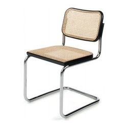 Cesca Side Chair | Design Within Reach - This totally tubular modern dining chair has been defying gravity since 1928. I'd say after remaining popular for over 80 years, it's proven it's timeless.