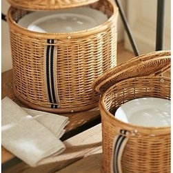 "Pantry Dinner Plate Woven Rattan Storage Basket - Our rattan baskets store extra dinnerware, and are beautiful enough for full display in a hutch. The rich, warm honey stain is accented with a touch of color on the durable striped handles. Small: 8.5"" diameter, 7"" high Large: 13.5"" diameter, 7"" high Handwoven rattan over an iron frame. Cotton lining. French-striped cotton canvas handles. Aluminum rivets. Made for Catere's Dinner and Salad Plate storage. Catalog / Internet Only."