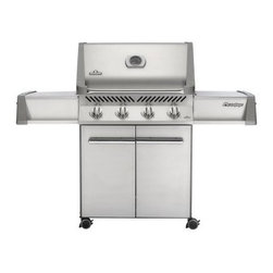 Napoleon Prestige P500 Gas Grill - The Napoleon Prestige P500 Gas Grill with its Jetfire ignition system gives chef's great coverage and an even distribution of heat across 4 stainless steel tube burners. This mobile unit stands on easy-roll locking casters that allow you to easily position your cooking area wherever you like and then set it firmly in place for safe grilling. Its expansive side shelves with integrated condiment trays give the cook plenty of room to set aside tools sauces rubs and plates so there's plenty of elbow room to get to what really matters - grilling! But of course you can't grill without fuel and this unit comes with a ventilated cabinet base that's great for hiding away your natural gas or propane tank (both options are available). Above the doors you'll find ergonomically designed knobs that put you in total control of the 4 burners within which can be monitored without losing a single degree of heat thanks to a temperature gauge built directly into the space-saving Lift Ease roll top lid! Of course when it's time to open that lid and see the sizzling dishes inside you'll be treated to a sight of exceptional engineering! The Napoleon Prestige Gas Grill features 4 burners capable of emitting up to 48 000 BTUs of heat evenly across a staggering 760 square inches of cooking space with the warming rack! That grilling area also happens to be made up of porcelainized cast iron which boasts the famed WAVE reversible cooking grids that are incredibly easy to clean plus there are some stainless steel sear plates as well for even more cooking options. For versatility and power the Napoleon Prestige P500 Gas Grill is miles ahead of the competition. About Napoleon GrillsRising up from its humble beginnings in Barrie Ontario Canada Napoleon Gourmet Grills has become North America's largest privately owned manufacturer of top-of-the-line wood and gas fireplaces gourmet gas and charcoal grills waterfalls and outdoor living products. It all started 1976 