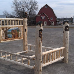 Queen carved bed - Queen sized log poster bed with sculpted posts and head board mural.