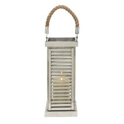 Benzara - Lantern with Minimalistic Design and Geometric Flair - This S/Steel Lantern 7 in. W, 25 in. H is sure to make for a wonderful decor accent. Chic and elegant, this Perfect for casual setups, this lantern can also be incorporated with urbane, contemporary interiors. Featuring simple slatted accents along the sides, this lantern exemplifies geometric flair and displays clean, smooth lines. The lean, tower-like design of this lantern gives the design a unique appeal and an ultra-modern, minimalistic design. The lantern is detailed with a smooth, charming finish which gives the design a characteristic appeal. Supported by a solid, secure base, this lantern can be installed on side-tables, shelves or window ledges for a warm, welcoming touch. Crafted from stainless steel, this lantern promises unmatched durability for long-lasting usage. Lightweight, this lantern can be hung anywhere inside or outside your house to enhance your decor. It is durably made from high grade material..