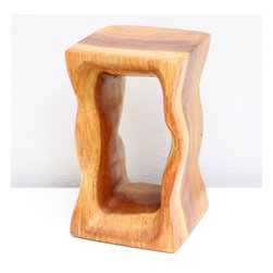 Kammika - Mini Natural Stool 4x4 x 6.75 inch H Sust Wood in Eco Friendly Livos Clear Oil F - Our Sustainable Monkey Pod Wood Mini Natural Stool 4 inch x 4 inch x 6.75 inch height in Eco Friendly, Natural Food-safe Livos Clear Oil Finish displays a wavy design with swirling textures that accentuates the flow of the graceful waves in the wood grain. These sturdy, versatile eco friendly functional art pieces are intricately carved small versions of some of our stool and stands. You can use as computer speaker stands or as display window stands for jewelry and other small objects. Finished in Livos Clear Oil allows you to see the wood naturally darken with age. Made from the branches of the Acacia tree in Thailand - where each branch is cut and carved to order (allowing the tree to continue growing), the wood is dried, carved and sanded by local artisans. They are then rubbed in Livos Clear tone oil creating a water resistant and food-safe matte finish. These natural oils are translucent, so the wood grain detail is highlighted. There is no oily feel and cannot bleed into carpets, as it contains natural lacs. Craftspeople from the Chiang Mai area in Northern Thailand create these unique pieces with the simplest of tools. We make minimal use of electric hand sanders in the finishing process. All products are dried in solar and or propane kilns. No chemicals are used in the process, ever. After each Monkey Pod wood (Acacia, Koa, Rain Tree grown for wood carving) piece is dried, carved, and sanded, it is rubbed with Livos oil, and then packaged with cartons from recycled cardboard with no plastic or other fillers. As this is a natural product, the color and grain of your piece of Nature will be unique, and may include small checks or cracks that occur when the wood is dried. Sizes are approximate. Products could have visible marks from tools used, patches from small repairs, knot holes, natural inclusions or holes. There may be various separations or cracks on your piece when it arrives. There may be some slight variation in size, color, texture, and finish color.Only listed product included.