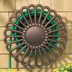 Whitehall Veneti Garden Hose Holder - About Whitehall Renowned as the world's largest manufacturer of weathervanes, Whitehall Products is also recognized for its extensive line of personalized home address plaques, mailboxes, and garden accents such as hose holders, birdbaths, birdfeeders, and sundials. Whitehall's home accent collection includes unique indoor/outdoor clocks, thermometers, and personalized doormats. Behind the legend of Whitehall artistry lies the tale of a unique craft inspired by the majestic shores and woodlands of western Michigan. It was one master wood-carver's desire to reproduce and preserve his hand-carved wood sculpture in metal, depicting the grace and essence of America's natural beauty. Over 65 years later, Whitehall Products still offers you the same mastery in detail with each originally designed, carved, and hand-cast product.