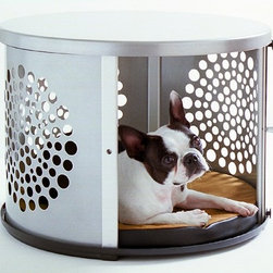 BowHaus Cat Crate by DenHaus - This create is so clever. The ventilation is made with a playful pattern of circles creating a circle and it has a sliding door that can stay open for the puppy/kitty to come in or out. Keep the door shut and no one will even know this is a crate, they'll think it's a beautiful modern side table.