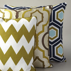 Geometric Pillows - Retro, mod, geometric prints like these are a fun way to add some eye-catching style to an otherwise-solid chair or couch.