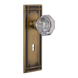 Nostalgic Warehouse - Nostalgic Mission Plate with Waldorf Knob and Keyhole in Antique Brass (715894) - The Mission plate in antique brass harkens to the Spanish Colonial period of the Western frontier, with an instantly recognizable square corner. Pair this with our Waldorf Knob, and its crisp clean edges, for a lucent look. All Nostalgic Warehouse knobs are mounted on a solid (not plated) forged brass base for durability and beauty.