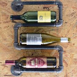 Down the Pipeline - Industrial pipe wine rack.  Holds 4 bottles of wine (pictured with 3 bottles).  Recommended to screw into wall studs.  Includes screws. Light assembly may be required to reduce cost of shipping.  6 bottle wine rack available for $80.00.