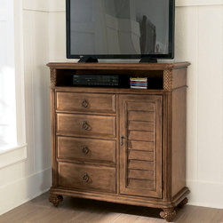 American Drew - American Drew Grand Isle Media Cabinet in Amber - The Grand Isle Collection is a lifestyle bedroom and dining room group that offers high end  yet casual up to date tropical style with multiple options for any room of the home; creating a collection that is perfect for many homes  vacation homes or even smaller size vacation condos. The amber finish has a warm overtone with subtle dark burnished accents that make the natural soft distressing show through. Design elements used in Grand Isle include carved and shaped pilasters  woven drawer fronts and a louver motif; all adding a higher end look to the collection. This collection is sure to add a relaxed  yet sophisticated style to most homes and offers plenty of options to help with storage and organization.