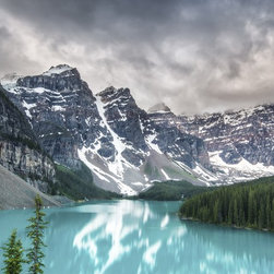 """""""Imaginary Waters"""" Artwork - I took this photograph at Lake Moraine in Banff National Park. It was a cold and cloudy day at the lake. The turquoise blue color of the lake reflected the snow covered mountains behind it. The green tree forest created a nice additional element to the scene on the right side of the image. On the left side of the landscape picture, the granite can be seen and shows the test of time while glaciers carved thru them."""