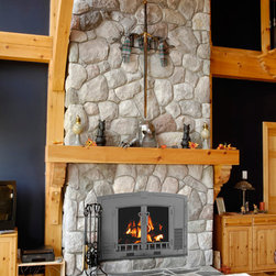 Fireplace Doors and Accessories - The Heat Champion series of wood-burning masonry fireplace doors by Stoll Fireplaces - made with built-in grate heaters to give you a higher volume of warm air in your home, cutting down on your heating bills!
