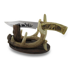 Zeckos - Rustic Decorative Black Bear Knife and Deer Antler Holder Set - Experience a taste of Northern wilderness when you display this decorative knife in your home or at the office. Made from cold cast resin with a hand-painted aged bone finish, it features stunning images of black bear standing in the trees on the unsharpened metal blade, and carved into the bone handle. This display knife even has its own tree stand It rests in a stand made of a set of stylized deer antlers and an old tree trunk, and measures 10.5 inches long, 6 inches high and 4.5 inches (27 x 15 x 11 cm) wide with the knife attached. It makes a glorious gift any true sportsman would be proud to display