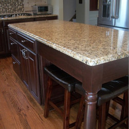 Kitchen Remodel,  Medina OH #4 - This kitchen was updated using Waypoint Raised Panel Cherry Cabinets accented with Nickel Hardware.  Granite Countertops in New Venetian Gold, Kohler Sterling Sink with Satin Nickel Artisan Faucets, and Antique Brushed Nickel Ceiling Mounted Lights were installed.