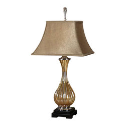 Uttermost Tisbury Gold Glass Lamp - Fluted golden tinted glass with polished aluminum accents and satin black details. Fluted golden tinted glass with polished aluminum accents and satin black details. The rectangle bell shade is a silken, golden taupe fabric.