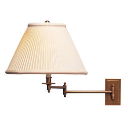 Robert Abbey - Kinetic Brass Wall Swinger - Articulate your light source with this maneuverable kinetic brass wall swinger. No, it's not a lifestyle choice, but a way to harness and direct your in-home lighting with an attractive, armed, wall mounted sconce. The natural pleat fabric shade makes the light creamy and delicious.