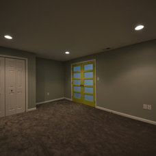 Contemporary Basement by ACH Group LLC