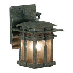Kenroy Home - Kenroy 91900RST Carrington Ex Sm Wall Lantern - The Carrington wall lanterns are a modern culmination of a classic wrought iron look that applies contemporary design to a familiar fixture of exterior lighting.  Amber and Frosted White glass pair beautifully with Rust and Black housings.