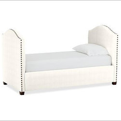 """Raleigh Nailhead Camelback Daybed, Washed Linen/Cotton Ivory - Crafted by our own master upholsterers in the heart of North Carolina, this daybed offers a cozy lounge space. Plush cushioning softens the front rail and sides, and oversized nailhead trim accents the camelback end panels. 84"""" wide x 43"""" deep x 48"""" high Crafted with a kiln-dried engineered hardwood frame. Side rails and slightly arched endboards are thickly padded and tightly upholstered with your choice of fabric. Nailhead detail trims the outer edges of the endboards. Optional trundle bed has an upholstered front panel that conceals trundle when not in use. Made in the USA."""