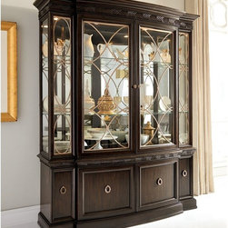 American Drew - Bob Mackie China Cabinet - 308-840R - Shop for China from Hayneedle.com! The Bob Mackie China Cabinet is a marvelous design crafted from a beautifully molded wood frame clear glass and jewelry inspired hardware. An elegant way to showcase your prized heirlooms and store dining room essentials this generously sized cabinet features finely detailed quilted maple veneers and bees wing prima vera accented by champagne colored metal on both its deck and base. The deck offers two wood-framed glass doors that open to nine adjustable glass shelves with plate grooves. This charming display is illuminated by four can lights with a touch dimmer and stands atop a functional base embellished with delicate carvings. Its two center doors open to a single adjustable shelf and an interior drawer with silver dray while the two outer doors conceal two adjustable shelves behind each. About American DrewFounded in 1927 American Drew is a well-established leading manufacturer of medium- to upper-medium-priced bedroom dining room and occasional furniture. American Drew's product collections cover a broad variety of style categories including traditional transitional and contemporary. Their collections range from the legendary 18th-century traditional Cherry Grove celebrating its 42nd year of success to the extremely popular Bob Mackie Home Collection influenced by the world-renowned fashion designer Bob Mackie. Jessica McClintock Home features another beloved designer bringing unique style to an American Drew line. American Drew's headquarters are located in Greensboro N.C. Their products are distributed through thousands of independently owned retailers throughout the United States and Canada and around the world.