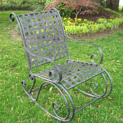 International Caravan - Wrought Iron Rocker w Scroll Black-Finished F - With a comfortable grid seat and back, this durable outdoor rocker will soon be your favorite companion. Made with sturdy iron, the frame still allows plenty of comfort with curved armrests, contoured seat and generous proportions. Comes in an antique black finish. Assembly Required. In antique black finish. Made of iron. Uses EP protection. Smooth scroll-work, comfortable glide. 26 in. W x 34 in. D x 34 in. H. Option to add a custom made cushion for added comfort and style