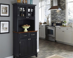 HomeStyles - Buffet Server with Hutch - An old-fashioned design that's dynamic in any space. Boldly black for a dramatic presence, this buffet features a cherry finish top that is the perfect accent for upper display shelving. Modern touches include brushed steel pulls and hinges on doors and drawers. * Buffet with two utility drawers. Two wood framed cabinet doors. Adjustable shelf for plenty of inside storage. Plexiglass doors with an adjustable shelf inside for plenty of storage. Brushed steel hardware. Made from Asian hardwood. Black finish. Made in Thailand. 31.25 in. W x 15.87 in. D x 71.5 in. H. Buffet Assembly Instructions. Hutch Assembly InstructionsHome Styles buffet-of-buffets is an expansive collection of buffets and hutches designed to provide added storage and workspace for the kitchen and dining areas of the home.