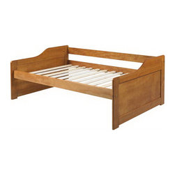 Rio Twin Daybed in Honey Pine - This Rio Twin Daybed in Honey Pine offers back rest for comfortable seating and curved arms with decorative plywood inserts. It is crafted from 100% Brazilian pine wood, which is kiln dried to prevent splitting and size distortion. All solid wood details are painted in identical color and finish. Twelve wood slats included eliminating need for a box spring. Slat supports are well glued and nailed with no staples. Rails are connected to posts by heat treated bolts and half moon nuts.