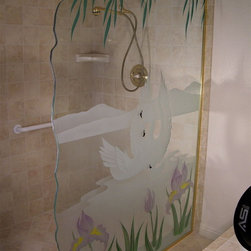 "Swan Song Glass Shower Partition - Shower in Illuminated Art ... Glass shower dividers and glass partitions by Sans Soucie are unique, custom works of art glass featuring hand-crafted, sandblast frosted and 3D carved designs.  Available any size, shape and with any design imaginable, a glass shower partition is the perfect solution for a walk in shower where you want to move from just plain glass to a custom look.  From simple frosted designs to our more extravagant 3D sculpture carved and painted glass , Sans Soucie designs are sandblasted different ways which create not only different effects but different levels in price.  The ""same design, done different"" - with no limit to design -  there's something for every decor, regardless of style.  Price will vary by design complexity and type of effect:  Specialty Glass and Frosted Glass.  Click here to learn more about our effects.   All shower divider glass is tempered, is custom made to order and ships worldwide at reasonable prices.  One of our most popular looks for partitions is a custom edge.  Edges can be straight polished, or can feature one of Sans Soucie's signature design custom hand chiseled, irregular edges."