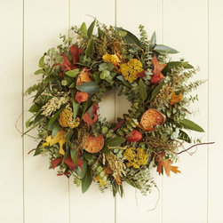 "Viva Terra - Fresh and Fragrant Wreath with Hanger - Our fragrant wreath captures the earthy floral scents of an autumnwalk through the woods. Made on a small family farm, the wreathis brimming with eucalyptus, sorghum, cydonia and preserved slicesof quince, all of which dry naturally to provide lasting vibrantcolors throughout the season. To prolong freshness, display indoorsor in a protected outdoor area. WREATH 18""DIAM , HANGER 12""L"