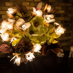 The Firefly Garden - Stars Fell on Alabama - In 1833, a spectacular meteor shower fell across the night skies of Alabama. One century later, Frank Perkins composed a jazz tune inspired by this historical event that would become a classic: Stars Fell in Alabama. Our own version of the tune sparkles with a composition of Gardenias, silk Hydrangea, Orchid, and Queen Anne's Lace to make a beautiful blend of history and light