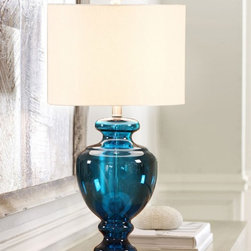 Blue Glass Trophy Base Table Lamp With Linen Shade - Earth tones and organic elements are beautifully represented in this simply shaped table lamp. The bottle shaped base is crafted of mercury glass, giving this lamp a beautiful ambiance.