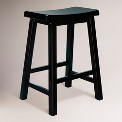 World Market - Antique Black Schoolhouse Counter Stool - A classic stool at an affordable price, our Antique Black Schoolhouse Counter Stool was created for versatility. The clean lines and sturdy construction include a seat curved for comfort and rails to rest your feet on.