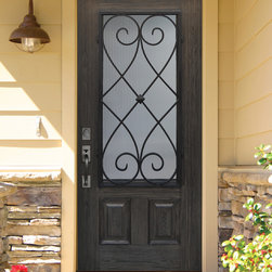 Premium Composite Door with Oak wood grain and Charleston grille - GlassCraft's wrought iron grille door made of premium fiberglass in oak grain and ebony color finish. Shown here with reeds glass texture and Charleston design grille. The wrought iron grilles are made of real iron for added security.