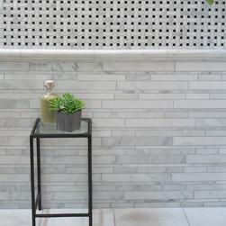 """Manhattan"" 12""x13"" polished stackstone mesh - Photo from Arizona Tile's website"