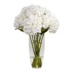 The French Bee - Hydrangea with Folliage in Glass Vase - Tall, bright and gentle, these beautiful white hydrangeas are made from silk and look just as good (or better!) than the real thing. Find a corner of your home that needs a spot of elegance and rest assured they'll stand at attention for years. A simple glass vase and faux water complete the illusion: only you'll know for sure they weren't just picked from the garden.