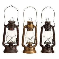 Benzara - Lantern Assorted in Classical Style - Set of 3 - This set of beautiful lanterns is sure to exude class and charm in the best possible way. With a unique blend of utility as well as artistic features, the set is a brilliant piece to own. The frame and main body of these lanterns are made of high quality metal that offers protection to the lantern and ensure long lasting performance. The orthodox pattern and the elegant structure of these lanterns make them visually pleasing and worthy to be showcased as an art piece. The base is broad and well balanced and serves as the storage tank for the fuel. Bearing the lamp unit, it contains the wick and adjustable key and is conveniently fixed in the tank. Sturdy metal frame protects the glass covering on both sides and the thin metal handle is convenient to carry the lantern around.