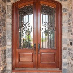 HeartWood Traditional Doors - Custom mahogany double door with iron decorative grills.
