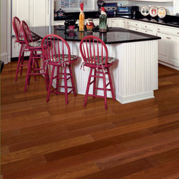 Santos Mahogany Hardwood Flooring - Santos Mahogany flooring is one of the most coveted exotic hardwoods in the world. Santos Mahogany hardwood has beautiful reddish brown to deep red color that remains constant over time, and its tight grain serves as an exquisite accompaniment to the rich colors with its fine, distinctive strokes. Like many Brazilian exotics, Santos Mahogany wood offers not only a beautiful visual appearance but astounding durability as well. With a Janka rating of 2,200, Santos Mahogany floors are 18% harder than Hickory floors, the hardest of North American hardwoods. For longevity and amazing looks, a Santos Mahogany floor is tough to beat.