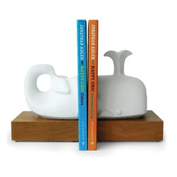 "Jonathan Adler - Jonathan Adler Whale Bookends - Our playful collection of ceramic animalsAnimals simplified into their essential forms accented with a layer of bold geometric pattern• high-fired stoneware with a matte white glaze• solid wood base• 10.5"" long x 7"" tallJonathan Adler pottery begins its life in our Soho studio, where Jonathan and his team design and sculpt every prototype. The product you are viewing is produced by skilled artisans at our main workshop in Peru. They make molds from our prototypes and then hand craft each piece from high-fired stoneware or porcelain. Our Peruvian workshop was found through Aid to Artisans, a non-profit organization that connects designers in America with artisans in developing countries to promote fair trade."