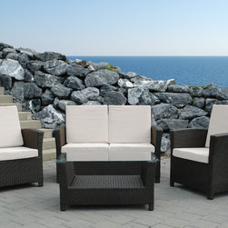 Beliani - Rimini by Beliani Resin Wicker Patio Sofa Set - Add a classic and stylish touch to your outdoor space with this four-piece garden sofa set. A durable wicker rattan defines this loveseat,arm chairs and coffee table.