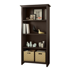 South Shore - South Shore Mill 4 Shelf Bookcase in Chocolate - South Shore - Bookcases - 7059767 - Ideal for your binders board games and decorative items this versatile 4-shelf bookcase can meet all of your storage needs. The finish and leg-shaped mouldings give this piece a Transitional look that works with any d��cor.