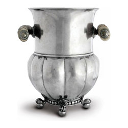 Medici Pewter Wine Bucket - A grand piece that you'll find yourself filling with flowers and pressing into service as a decorative vessel between parties, the Medici Pewter Wine Bucket is alive with dignified detail: a melon-formed, domed bottom on coquille-accented ball feet, plus side handles in a palatial form. Heaped with ice or preserving the temperature of a vintage, this wine bucket speaks of assured taste.
