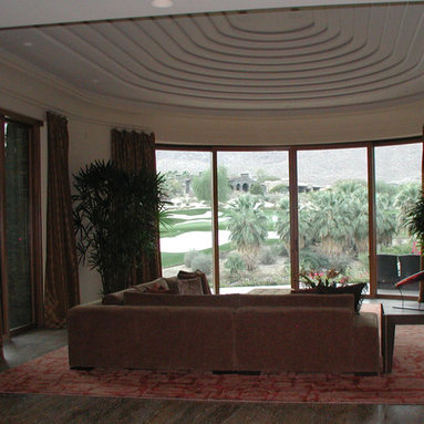 Custom Draperies - Stationary pleated panels with slouched heading installed on stainless steel medallions to soften and frame the view with a slight break at the floor.