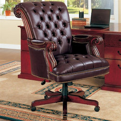 Coaster - Executive Chair in Brown - Leather-like vinyl upholstery. High back. Attached arms. Pneumatic seat height adjustment. Exposed wood scroll arms. Classic nail head trim accents. Adjustable height gas lift. Casters below wooden base. 29.5 in. W x 37.5 in. D x 42.5 in. - 45.5 in. H. WarrantyThis sophisticated executive office chair will add both style and comfort to your home office. Create a warm and stylish home office with this beautiful traditional executive chair.