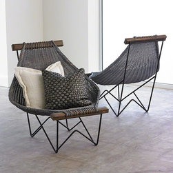 Studio A - Studio A Spinnaker Chair - Sink deeply and relax into the Spinnaker Chair which takes its name from a wind-filled sail. The weave was inspired by a vintage technique and is hand-woven by artisans in Vietnam. The gray-washed rattan chair sits upon an iron, powder-coated base; acacia wood frame. Not intended for outdoor use.