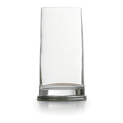 Milano Highball - Unusually shaped for a pleasing note of playful personality while keeping your look sophisticated and suave, the Milano Highball glass has the usual tall, cylindrical shape of this drinkware style, but tapers to a pewter oval at the base e handsome and distinctly European, but delightfully unconventional. The glass and pewter in the vessel were handmade in Italy.