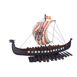 Handcrafted Nautical Decor - Viking Drakkar with Embroidered Raven Limited 24'' - NOT A MODEL SHIP KIT--Attach Sail and the Drakkar Viking longship model is Ready for Immediate Display-- --Share the courageous spirit of adventure that made the  vikings the greatest explorers, traders and feared raiders of their age  with this replica Drakkar Viking with Embroidered Raven longship model.--24'' Long x 15'' Wide x 16'' High------    Hand crafted by master artisans--    High quality woods used in construction--    Quality construction features:--    --        Lightly starched, quality       cloth sails do not sag or wrinkle--        Colorful shields lining gunwale--        --        Hand embroidered raven prominently displayed on sail--    --    --    Sturdy wooden base attached to longboat model--    --    Pre-assembled, simply attach the sails and      display--    --        Separate pre-assembled hull       and sails ensure safe shipping and lower cost--        Sails and rigging already       complete--        Insert mast in designated hole       and clip brass rigging hooks as shown in illustrations--        Ready to display in less than two minutes--    --    --