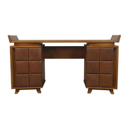 Herman Miller - Pre-owned Gilbert Rohde for Herman Miller Vintage Desk - A sculptural desk by Gilbert Rohde for Herman Miller. We like to call this baby the Cadillac of desks - it has wings!! Floating top with leatherette covered front drawers. Restored.