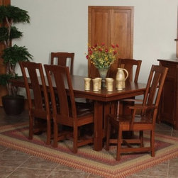 Goshen Amish 5 piece Dining Table Set - A recreation of the traditional Mission design for the modern home the Goshen Amish 5 pc. Dining Table Set makes a wonderful addition to any dining area. Whether it's an apartment in the city or a sprawling country house this set which includes an extendable dining table two dining arm chairs and two side chairs will make an impression with its clean lines timeless charm and superior Amish woodworking adding upscale elegance to any setting.Crafted from responsibly harvested oak hardwood this sturdy dining set sports a beautiful multi-step cherry finish that adds warmth to any setting. Boasting a classic slatted base this table extends from 72 to 96 inches with two 12-inch leaves. This means that even if you have last-minute guests you can easily accommodate them at your table. The chairs' clean lines highlight its classic elegance while the generous seat and tall single-slat supportive back envelop you in comfort encouraging you to linger at the table longer than necessary. A timeless masterpiece sure to be cherished for years to come this dining set is sure to be the highlight of any dining area.Additional Features:Dining table dimensions: 72L x 42W x 30H inchesDining arm chair dimensions (each chair): 26W x 17D x 41H inchesDining side chair dimensions (each chair): 16W x 17D x 41H inchesMission design with mission table edge and slatted baseComfortably seats 4 peopleMade in AmericaCare and Maintenance:Because most hardwoods are open grained solid wood furniture can be affected by changes in humidity and temperature even after protective finishes have been applied. Care in controlling the furniture's environment will help minimize the minor cracking and warping that is a natural part of the wood's character.Indoor humidity should be kept in the 35 to 40 percent range to minimize these effects. If the humidity moves out of the ideal range solid wood tabletops can expand or contract causing a gap in the center or at the ends where the two halves meet. This is perfectly normal as moisture is absorbed through end grains of wood causing more movement on the ends of the table than in the center. Through change of seasons these changes will occur according to humidity levels. Additionally direct sunlight and fluorescent fixtures that contain ultra-violet rays can cause chemical changes in the wood and finish and should be avoided. Furniture should also be kept away from direct sources of heating and cooling and out of attic or basement storing environments. With proper care solid wood furniture will provide a lifetime of enjoyment and can be passed on to future generations.About Fusion Designs:Backed by decades of experience in the furniture industry Fusion Designs offers some of the best hardwood dining occasional and hospitality furniture in the USA. Committed to maintaining the high standards of quality they are known for Fusion Designs prides itself on a work ethic instilled by generations of craftsmen. Having started off as a simple Amish woodworking shop Fusion Designs has today become a place where the foundation of the American heritage is honored while the pursuit of innovative design ensures scaling even greater heights in customer satisfaction in the future.