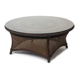 Lloyd Flanders Grand Traverse 42 in. Round Conversation Table - The Lloyd Flanders Grand Traverse 42 in. Round Conversation Table is a smart and easy way to bring classic patio style to your home. The timeless old rattan aesthetic is crafted from unique vinyl and hand-woven for quality. Constructed with weather-resilient resin wicker, this handsome table is designed to withstand years of inclement elements without fading, rotting or cracking from exposure to harsh weather conditions. The quick-dry material allows for year-round use.The open-lattice design is topped with a tasteful layered round table surface. The lay-on glass top removes easily for the winter months to ensure longevity. The low height makes this table and ideal conversational piece. Choose from a variety of frame finishes for the table that best complements your patio, deck or outdoor space.About Lloyd/FlandersCarrying on the traditions of Marshall B. Lloyd, Lloyd/Flanders brings the sophistication of timeless furniture designs to a sophisticated, modern audience. Using modern production processes and materials, these classic styles are faithfully rendered in a way that can be enjoyed by customers anywhere with high-quality construction and reliable, all-weather designs.