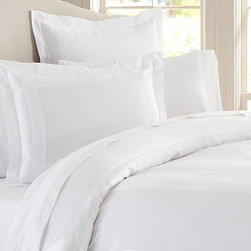 Hotel 600-Thread-Count Sham, Standard, White - Like bedding found in the finest luxury hotels, our duvet cover and sham are sateen woven to a luxurious 600-thread-count, giving them supersoft texture and a silky luster. Made of 100% cotton sateen. 600-thread count. Duvet and sham reverse to self. Duvet cover has a hidden button closure and interior ties to keep the duvet in place; sham has an envelope closure. Duvet cover, sham and insert sold separately. Machine wash. Made in Italy. Monogramming is available at an additional charge. Monogram will be centered on the duvet cover and the sham.